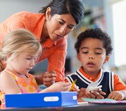 teacher-helping-boy-and-girl