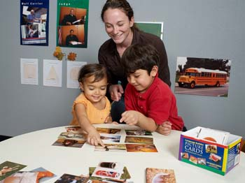 woman-teaching-two-kids-language-with-pictures
