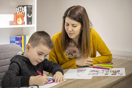 ABA therapist for autism working with a student