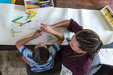 ABA-therapy-counselor-coloring-with-child