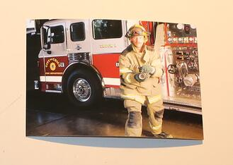 male-firefighter-by-fire-truck
