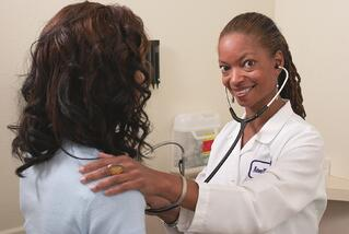 female-doctor-listening-to-woman's-heart
