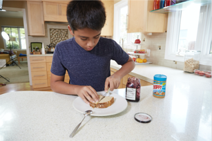 autistic boy sequencing making sandwich