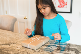 autistic girl sequencing tying package