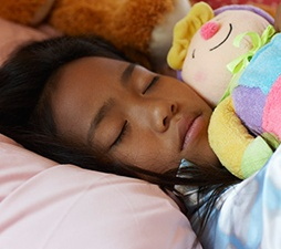 child-sleeping-with-doll.jpg