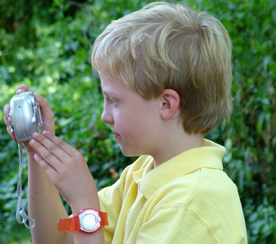 boy-taking-a-picture-outside