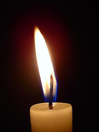 lit-candle-in-the-dark