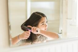 girl-brushing-hair