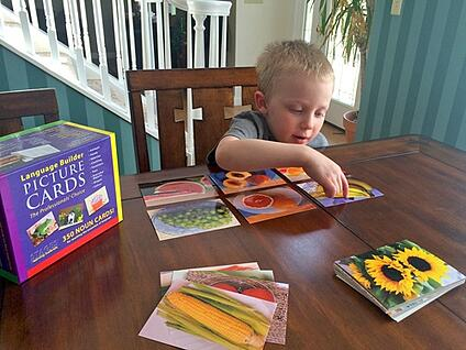 boy-using-language-builder-cards-pointing-to-banana-card