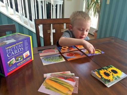 boy-using-language-builder-cards-pointing-to-banana-card