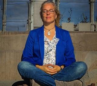 woman-meditating-outside