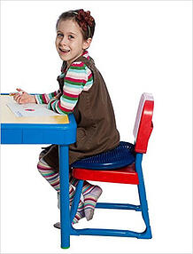 girl-drawing-a-picture-while-sitting-on-a-chair-cushion