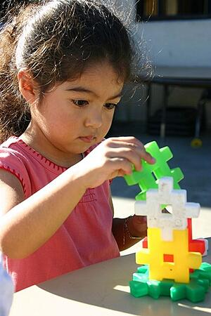 girl-playing-with-stackable-toys