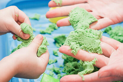 Children with autism playing kinetic colored sensory sand