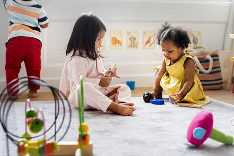 Little kids autism mixed races playing toys in the playroom