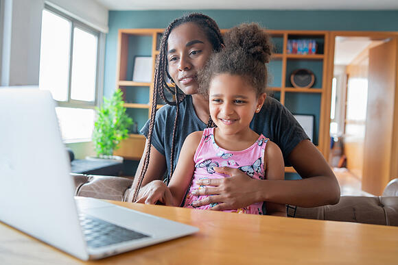 Mother and daughter with autism on a video call with a telehealth provider