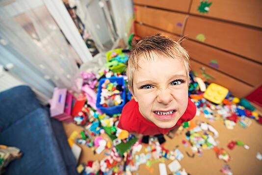 Naughty and messy little boy with autism