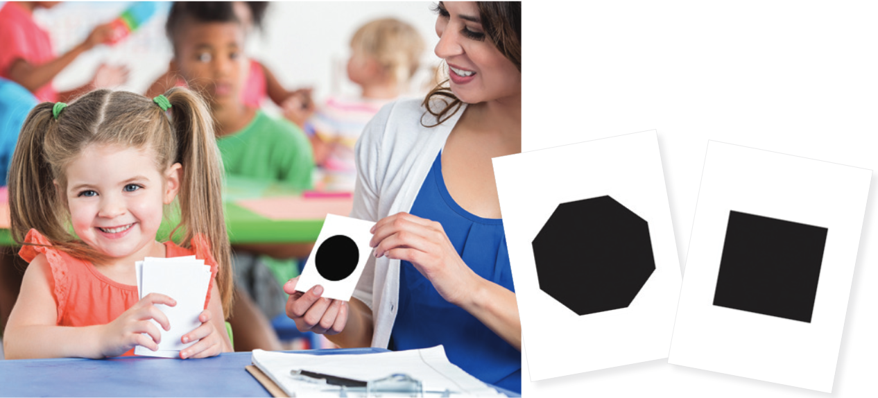 autistic girl with autism using interactive cards with teacher