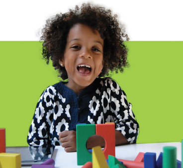 happy-girl-playing-with-building-blocks