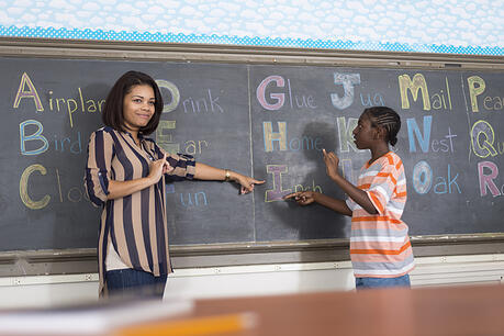 boy receiving support services in special education classroom