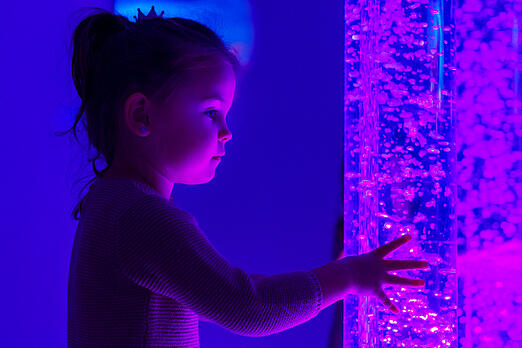 child with autism interacting with colored lights