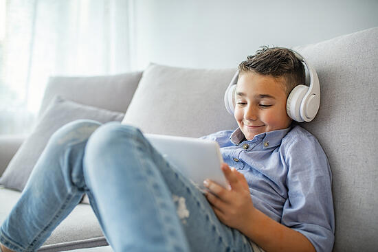 child with autism learning independently wearing headphones