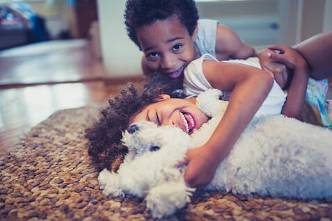 children with autism having fun playing with their dog