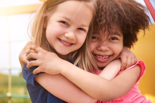 children with autism hugging