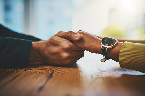 couple-holding-hands-at-a-table