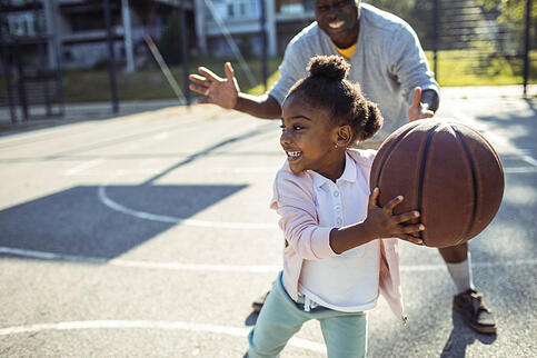 daughter-playing-basketball-with-dad