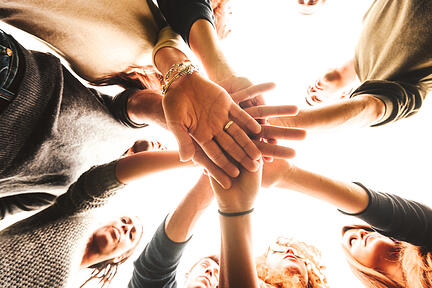 family hands in a circle