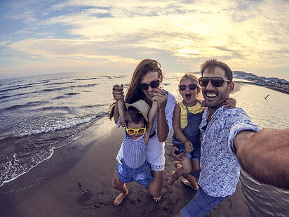 family laughing at autism friendly beach resort