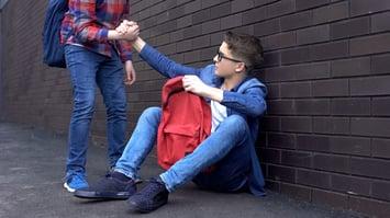 friend-helping-boy-up