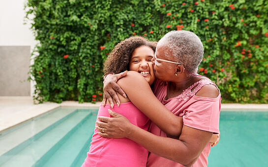 girl with autism hugging grandmother