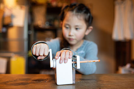 girl with autism sharpening a pencil