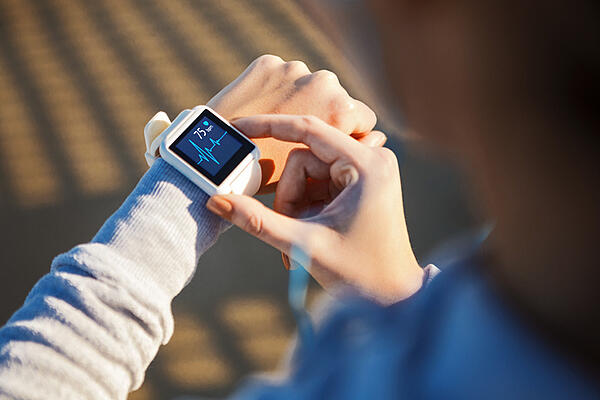 girl-using-smartwatch-to-track-heartrate