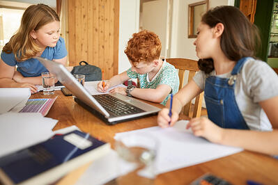 group of kids doing homework together supporting student with autism