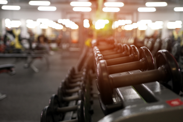 gym-weights-equipment-with-bright-lights