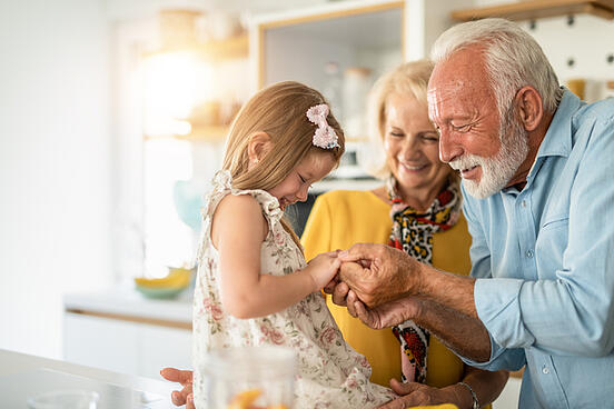 little girl with autism happy with grandparents