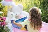 girl-reading-to-stuffed-animals