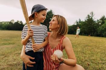 mother-and-son-enjoying-baseball