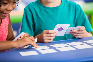 girl-and-boy-playing-a-pattern-card-game