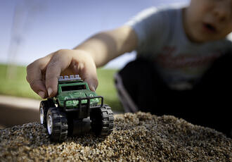 playing with a toy truck