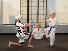 three-children-practicing-karate.png
