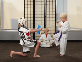 three-children-practicing-karate.png