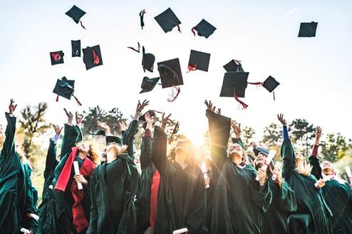 university-students-graduating-throwing-caps-autism